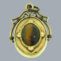 Vintage early gold tone Pendant/Locket with tiger eye stones