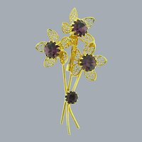 Vintage floral gold tone Brooch with purple rhinestones