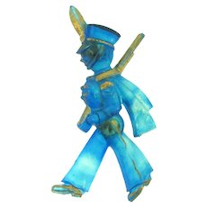 Vintage early plastic marching soldier Brooch