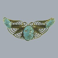 Vintage gold tone filigree Brooch with mottled blue glass stones
