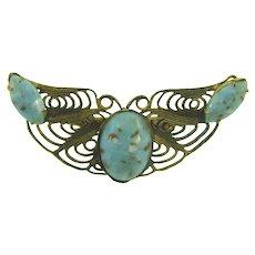 Vintage gold tone filigree Brooch with mottled blue glass stones