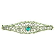 Vintage silver tone filigree Bar Pin with emerald green rhinestone