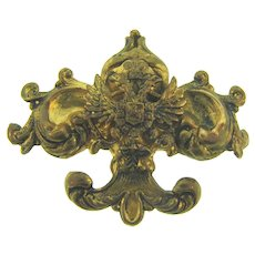 Vintage gold tone regal Brooch in a baroque style