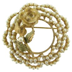Signed BSK circular raised floral Brooch with imitation pearls
