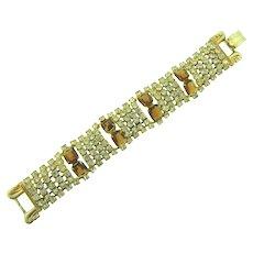 Vintage gold tone wide rhinestone Bracelet with crystal and dark topaz stones