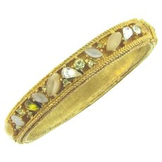 Signed ART gold tone clamper Bracelet with rhinestones
