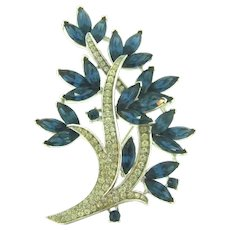 Signed Crown Trifari floral spray Brooch with crystal and blue rhinestones
