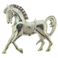 Signed Hollycraft figural silver tone horse Brooch with purple rhinestones