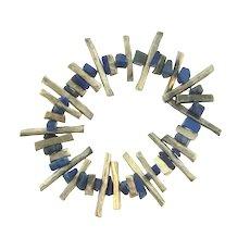 Vintage brutalist stretch Bracelet of silver tone rods and lapis lazuli stone chips
