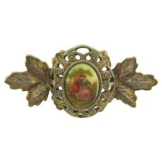 Vintage gold tone Brooch with courting couple early plastic cabochon