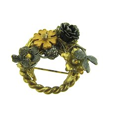 Signed DeMario Hagler N.Y.C. small circular gold tone Brooch with flowers, thistles and shamrocks