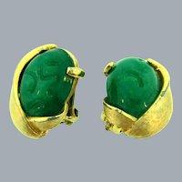 Signed Kramer clip back Earrings with green glass stones