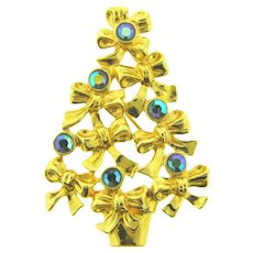 Signed Avon 1992 Christmas tree Brooch with blue AB rhinestones