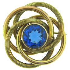 Marked R.G.P. (rolled gold plate) Celtic Knot Brooch with blue glass stone