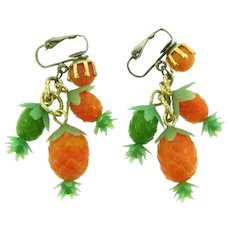 Marked Hong Kong plastic dangling pineapple clip back Earrings