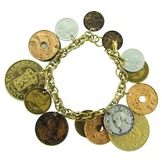 Signed Coro vintage foreign coin gold tone charm Bracelet