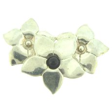 Marked sterling floral Brooch with black glass bead