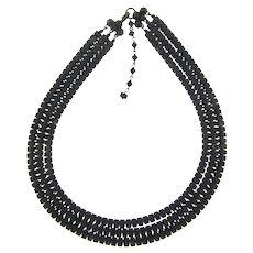 Marked Made in Austria triple strand black glass beaded Necklace