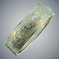 Vintage silver tone wide bangle Bracelet with repousse floral design
