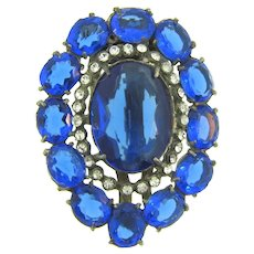Vintage large pot metal Dress Clip with blue and crystal rhinestones