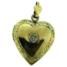 Marked 1/20 10K on sterling silver vermeil heart Locket with tiny diamond