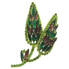 Vintage 1960's floral Brooch with shades of green and purple rhinestones