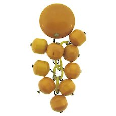 Vintage Bakelite button butterscotch Brooch with dangling Bakelite beads and celluloid rings