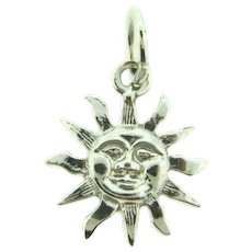 Marked Sterling silver figural Sun Charm