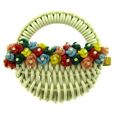 Vintage early braided plastic flower basket Brooch with multi colored flowers