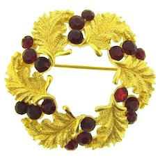 Signed Crown Trifari gold tone wreath Brooch with red rhinestones