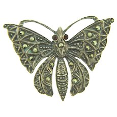 Marked 925 CL sterling silver figural butterfly Brooch with marcasites and red rhinestones