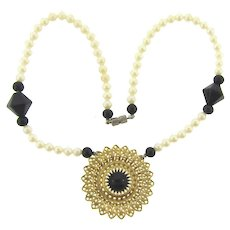 Vintage pendant necklace with imitation pearls and black glass beads