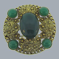 Vintage gold tone floral Brooch with green glass cabochons