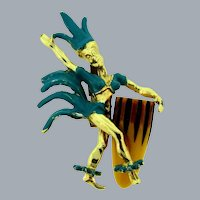 Vintage gold tone figural dancer with plastic drum Brooch