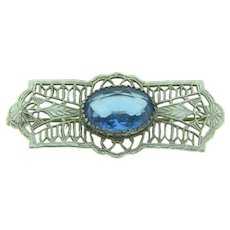 Vintage silver tone filigree early Brooch with blue glass stone