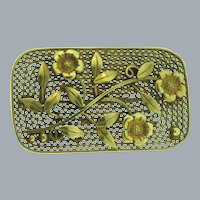 Marked Czechoslovakia lattice Brooch with floral design