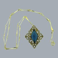 Vintage gold tone Necklace with gold tone pendant with large blue glass stone