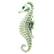 Vintage silver tone figural seahorse Scatter Pin with blue rhinestone