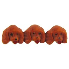 Vintage early plastic figural Bar Pin of three dogs