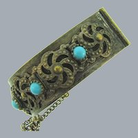 Vintage gold tone bangle Bracelet with side clasp and turquoise glass cabochons