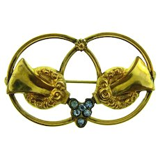 Vintage gold tone double circle Brooch with small blue rhinestones