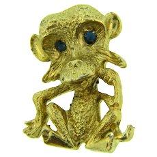 Vintage cute figural monkey Brooch with blue rhinestone eyes