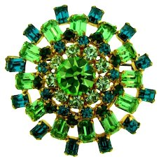 Marked Austria domed rhinestone Brooch in green tones