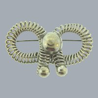 Vintage unusual Art and Crafts style coiled silver tone bow Brooch