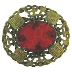 Large Oriental style Brooch with molded floral glass piece