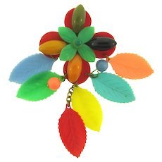 Vintage hard plastic and Bakelite floral Brooch with dangling leaves