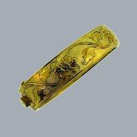 Vintage gold tone hinged bangle Bracelet with floral design