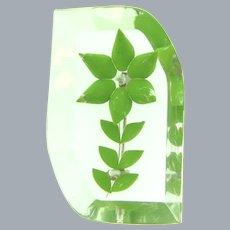 Vintage reverse carved Lucite Brooch with green enamel flower