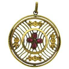 Vintage large gold tone circular Pendant with dark pink rhinestone petals flower