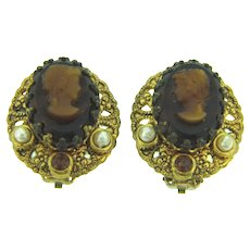 Marked West Germany clip-on Earrings with glass cameos, imitation pearls and dark topaz rhinestones